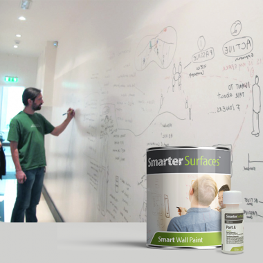 man drawing freely on wall finished in Smart Whiteboard Paint - expand your creative space